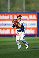 Canisius College Golden Griffins left fielder Tim Kensinger (10) throws the ball in during the second game of a doubleheader against the Michigan Wolverines on February 20, 2016 at Tradition Field in St. Lucie, Florida.  Michigan defeated Canisius 3-0.  (Mike Janes/Four Seam Images)