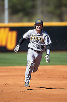 Drew Davis (16) of the Kennesaw State Owls hustles towards third base against the Winthrop Eagles at the Winthrop Ballpark on March 15, 2015 in Rock Hill, South Carolina.  The Eagles defeated the Owls 11-4.  (Brian Westerholt/Four Seam Images)