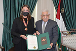 Palestinian president Mahmoud Abbas honors Swedish Consul General Jessica Olsson, in the West Bank city of Ramallah on August 1, 2021. Photo by Thaer Ganaim