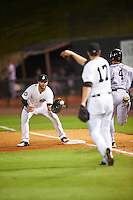 Jackson Generals first baseman D.J. Peterson (33) waits for a throw from pitcher Matt Anderson (17) as J.T. Riddle (4) runs up the base line during a game against the Jacksonville Suns on May 4, 2016 at The Ballpark at Jackson in Jackson, Tennessee.  Jackson defeated Jacksonville 11-6.  (Mike Janes/Four Seam Images)