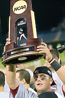 South Carolina 1B Christian Walker lifts the championship trophy follwing Game Two of the NCAA Division One Men's College World Series Finals on June 29th, 2010 at Johnny Rosenblatt Stadium in Omaha, Nebraska.  (Photo by Andrew Woolley / Four Seam Images)