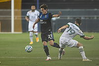 SAN JOSE, CA - SEPTEMBER 19: Carlos Fiero #21 of the San Jose Earthquakes goes by Tomas Conechny #19 of the Portland Timbers during a game between Portland Timbers and San Jose Earthquakes at Earthquakes Stadium on September 19, 2020 in San Jose, California.