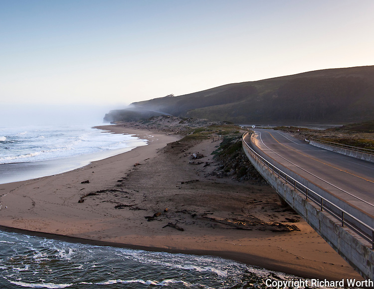 Highway 1, the Cabrillo Highway, paralleling the ocean and crossing Pescadero Creek on an early spring morning.