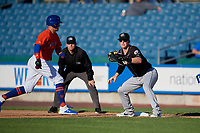 Charlotte Knights first baseman Zack Collins (8) waits for a throw as Brandon Nimmo gets back to the bag with umpire Brian Peterson looking on during an International League game against the Syracuse Mets on June 11, 2019 at NBT Bank Stadium in Syracuse, New York.  Syracuse defeated Charlotte 15-8.  (Mike Janes/Four Seam Images)