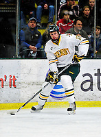 26 November 2010: University of Vermont Catamount defenseman Anders Franzon, a Sophomore from Plattsburgh, NY, looks to center a pass during play against the Northeastern University Huskies at Gutterson Fieldhouse in Burlington, Vermont. The Huskies came back from a 2-0 deficit to earn a 2-2 tie against the Catamounts. Mandatory Credit: Ed Wolfstein Photo