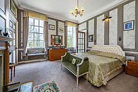 BNPS.co.uk (01202 558833)<br /> Pic: KnightFrank/BNPS<br /> <br /> Pictured: A bedroom.<br /> <br /> A spectacular Georgian mansion that was home to an eccentric and legendary poet during the war is on the market for £10.5m.<br /> <br /> Grade II* Listed South End House was home to Walter de la Mare in the 1940s and the writer was reprimanded for failing to observe the blackout during the Second World War.<br /> <br /> The impressive property is in a prime location on an exclusive cul-de-sac with incredible park views and glimpses of the Thames.<br /> <br /> On one occasion during the war, police rowed across the river to complain his upper windows were beaconing to the far bank.