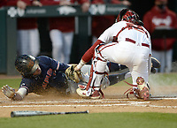 Arkansas catcher Casey Opitz (right) applies the tag Thursday, April 1, 2021, to Auburn second baseman Brody Moore during the fifth inning of play at Baum-Walker Stadium in Fayetteville. Visit nwaonline.com/210402Daily/ for today's photo gallery. <br /> (NWA Democrat-Gazette/Andy Shupe)