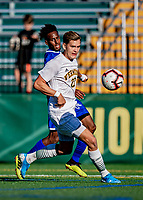 26 October 2019: University of Massachusetts Lowell River Hawk Midfielder Abdi Shariff-Hassan, a Junior from Lewiston, Maine, battles University of Vermont Catamount Defender Ívar Örn Árnason, a Senior from Akureyri, Iceland, in second half action at Virtue Field in Burlington, Vermont. The Catamounts rallied to defeat the River Hawks 2-1, propelling the Cats to the America East Division 1 conference playoffs. Mandatory Credit: Ed Wolfstein Photo *** RAW (NEF) Image File Available ***