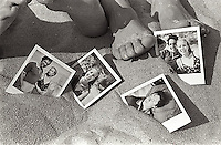 Polaroids of couple in sand by their feet<br />