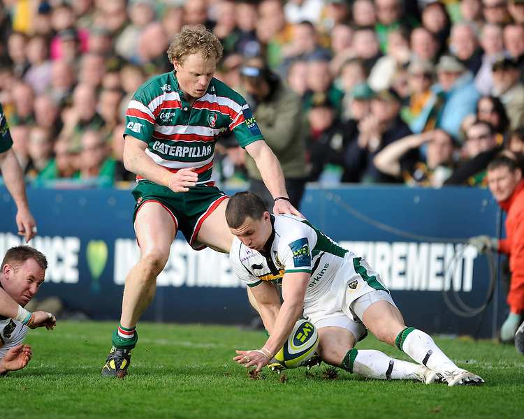 Vasily Artemyev of Northampton Saints goes to ground on a loose ball as Scott Hamilton of Leicester Tigers approaches during the LV= Cup Final match between Leicester Tigers and Northampton Saints at Sixways Stadium, Worcester on Sunday 18 March 2012 (Photo by Rob Munro, Fotosports International)