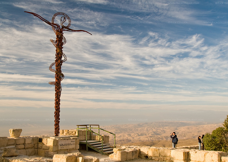 """A stylized """"Jesus crucified"""" overlooks the view of the Promised Land (now Israel), as Moses must have seen it at the top of Mt. Nebo, Jordan. Today a Christian church stands here, but across the ages, peoples of all religions have been able to worship here without persecution.  This was even true in as Christians were persecuted elsewhere in Ancient Rome, and continued though the Crusades and the Islamic caliphates, all the way to today. © Rick Collier"""