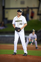 UCF Knights relief pitcher Campbell Scholl (30) gets ready to deliver a pitch during a game against the Siena Saints on February 17, 2017 at UCF Baseball Complex in Orlando, Florida.  UCF defeated Siena 17-6.  (Mike Janes/Four Seam Images)