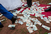 Nigeria. Enugu State. Awhun. Igbo traditional wedding ceremony. Blessing Amusiogo is the bride, and Michael Ogbo the groom. As a custom during the wedding party, friends of the newlywed couple have thrown Naira banknotes in the air. The money will be picked up on the ground by relatives. The married couple will receive it later as a wedding gift. The Naira is the currency of Nigeria. 29.06.19 © 2019 Didier Ruef