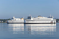 Two Steamship Authority ferries pass each other in Vineyard Haven Harbor on Woods Hole to Martha's Vineyard ferry run.
