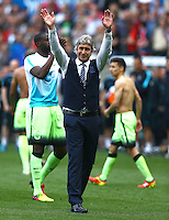 Manchester City manager Manuel Pellegrini waves goodbye to the City fans at full time during the Barclays Premier League match between Swansea City and Manchester City played at The Liberty Stadium, Swansea on 15th May 2016