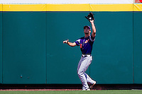 Andy Lasher (7) of the Evansville Purple Aces catches a fly ball to right field during a game against the Missouri State Bears at Hammons Field on May 12, 2012 in Springfield, Missouri. (David Welker/Four Seam Images).