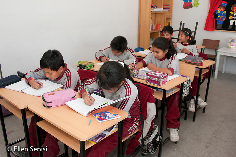 Arequipa, Peru. Hefziba, a parochial (Christian), private school for elementary and secondary school students. Students (middle-school age, Peruvian) sit in pairs and work on schoolwork in class. No MR. ID: AL-peru.