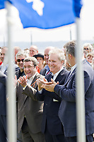 Quebec city mayor Regis Labeaume, left, Quebec Premier Jean Charest, center, and Quebec city region minister Philippe Couillard applause at the inauguration of the Promenade Samuel-de-Champlain Tuesday June 24, 2008 in Quebec City. The Promenade, a 2.5km parkway along the St-Lawrence River, is the gift from the government of Quebec to Quebec city for her 400th's birthday<br /> <br /> PHOTO :  Francis Vachon - Agence Quebec Presse