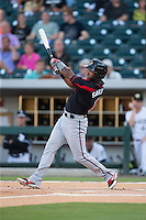 Danny Santana (1) of the Rochester Red Wings follows through on his swing against the Charlotte Knights at BB&T BallPark on August 8, 2015 in Charlotte, North Carolina.  The Red Wings defeated the Knights 3-0.  (Brian Westerholt/Four Seam Images)