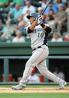Catcher Roberto Pena (10) of the Lexington Legends, a Houston Astros affiliate, in a game against the Greenville Drive on May 3, 2012, at Fluor Field at the West End in Greenville, South Carolina. (Tom Priddy/Four Seam Images).
