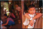A Laotian boy, photographed at his village of Ban Khe, Laos on August 29, 2006.  (photo by Khampha Bouaphanh)