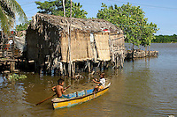 Children of the Anu-Parajuana ethnic group paddle a canoe in the Sinamaica Lagoon. Living much like their ancestors the Anu-Parajuana build simple houses on stilts.