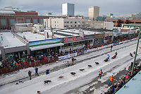 Ray Redington Jr. runs down 4th avenue during the Ceremonial Start of the 2016 Iditarod in Anchorage, Alaska.  March 05, 2016