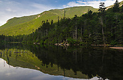 Greeley Ponds Scenic Area - Reflection of mountain in Upper Greeley Pond in Livermore, New Hampshire during the summer months. Located in the White Mountains in between Mount Kancamagus and the East Peak of Mount Osceola, the 810-acre Greeley Ponds Scenic Area was designated a scenic area in 1964.