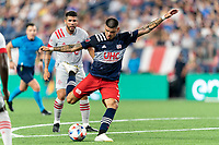 FOXBOROUGH, MA - JULY 7: Gustavo Bou #7 of New England Revolution takes a shot during a game between Toronto FC and New England Revolution at Gillette Stadium on July 7, 2021 in Foxborough, Massachusetts.