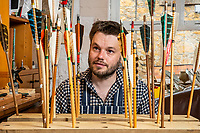 BNPS.co.uk (01202 558833)<br /> Pic: MaxWillcock/BNPS<br /> <br /> Pictured: Jonathan Hodgson inspecting his arrows in his studio in Ilminster, Somerset.<br /> <br /> A skilled fletcher has set up a business making artistic and competition arrows after being inspired by Lord of the Rings.<br /> <br /> Jonathan Hodgson adopts Medieval techniques to fashion them out of sustainable timbers, using precious stones for the arrow head.<br /> <br /> The feathers are humanely collected from turkey or geese and bound on with silk in a process which takes several days.<br /> <br /> The 37 year old, from Ilminster, Somerset, made his first arrows out of bamboo and slate as a child living in a farmhouse with plenty of land.