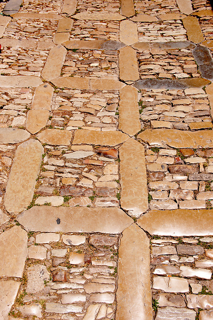 Polished stones of the roads of Érice, Erice, Sicily stock photos.