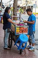 Bangkok, Thailand.  Streetside Fruit Stand: Papayas, Pineapple, Apples.