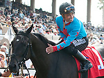 August 8, 2011.Mike Smith riding Joker Face in the winner's circle after winning the match race against Chantal Sutherland riding Parable at Del Mar Thoroughbred Club, Del Mar CA