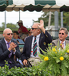 Wheelchair tennis Champion, Brad Parks(USA) waves to the crowd. 2015 Inductee and Paralympic champion, David Hall (AUS) is to the left. David's coach, Rich Berman is at right, at  the 2015 Induction Ceremony at the International Tennis Hall of Fame, Newport, RI USA.  The ceremony took place on July 18, 2015