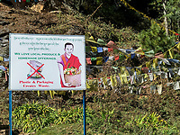 Bumthang, Bhutan.  Environmental Sign, Discouraging Plastic Waste, Encouraging Locally-grown Food.  By Enbtrance to Kurje Lhakhang Temple.