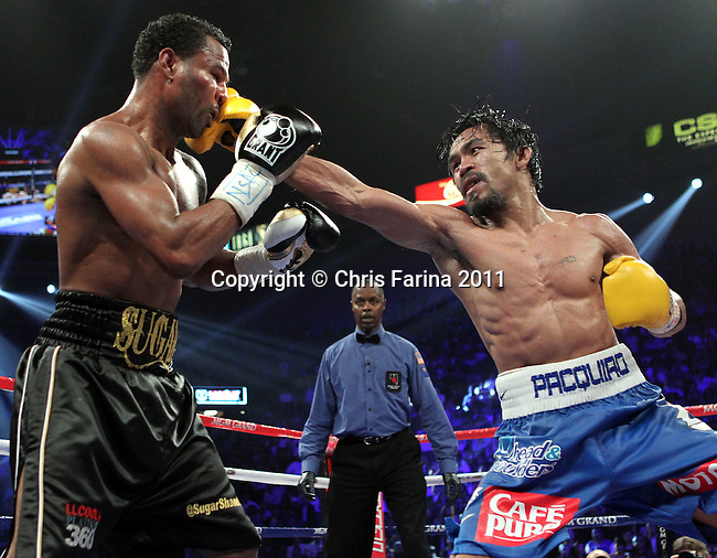 """May 7, 2011,Las Vegas,Nevada  --- Superstar Manny Pacquiao(R) wins a 12 round unanimous decision against """"Sugar"""" Shane Mosley at the MGM Grand Garden Arena in Las Vegas.  --- Photo Credit : Chris Farina - Top Rank  (no other credit allowed)  copyright 2011 ."""