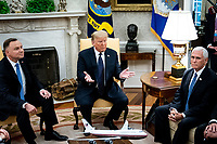 United States President Donald J. Trump and Polish President†Andrzej Duda during a bilateral meeting in the Oval Office of the White House in Washington, DC on June 24, 2020. From left to right: President Duda, President Trump, US Vice President Mike Pence.<br /> Credit: Erin Schaff / Pool via CNP/AdMedia