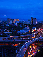 Moon rise, traffic and Architecture and High-rise Buildings in Manila, Philippines