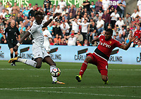 (L-R) Tammy Abraham of Swansea City has his shot blocked by Adrian Mariappa of Watford during the Premier League match between Swansea City and Watford at The Liberty Stadium, Swansea, Wales, UK. Saturday 23 September 2017