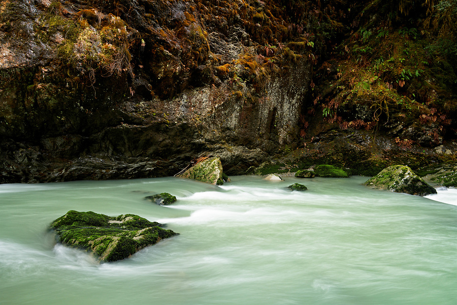 Boulder River flowing below mossy cliff, Boulder River Wilderness, Central Cascades, Washington, USA