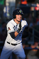 Grant Heyman (12) of the Hillsboro Hops runs to first base during a game against the Boise Hawks at Ron Tonkin Field on August 21, 2015 in Hillsboro, Oregon. Boise defeated Hillsboro, 7-1. (Larry Goren/Four Seam Images)