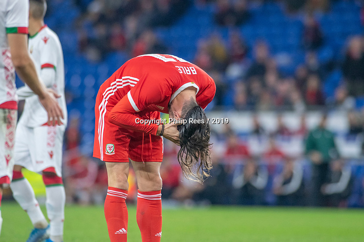Cardiff - UK - 9th September :<br />Wales v Belarus Friendly match at Cardiff City Stadium.<br />Gareth Bale of Wales ties his hair back up in the second half<br />Editorial use only