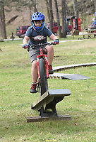 TEST AT THE FEST<br />Koston Seay, 9, pedals Saturday April 3 2021 over a teeter-totter at a skills course for kids during the 32nd annual Ozark Mountain Bike Festival at Devil's Den State Park. The festival  featured guided group mountain bike rides for beginner and experienced riders, instructional rides to improve riding technique, bike limbo and big splash contest. Riders were also allowed pedal over some of the new trails in the park that will not officially open for about a month. Go to nwaonline.com/210404Daily/ to see more photos.<br />(NWA Democrat-Gazette/Flip Putthoff)