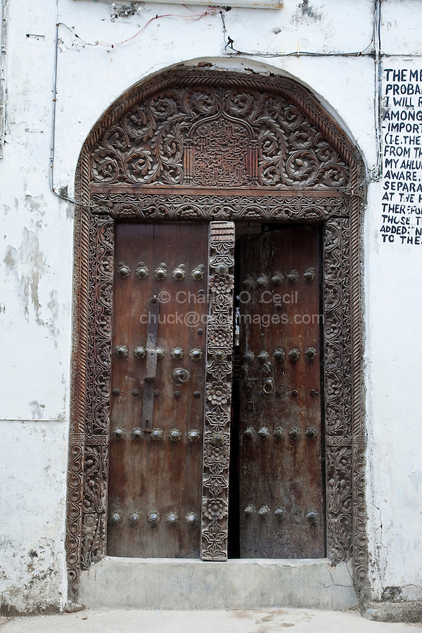 Stone Town, Zanzibar, Tanzania.  Mosque Entrance, Indian-style Door.  Arabic Calligraphy above the door.