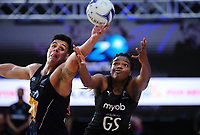 NZ Men's Jake Schuster and Silver Ferns' Grace Nweke compete for the ball during the Cadbury Netball Series match between NZ Silver Ferns and NZ Men at the Fly Palmy Arena in Palmerston North, New Zealand on Thursday, 22 October 2020. Photo: Dave Lintott / lintottphoto.co.nz