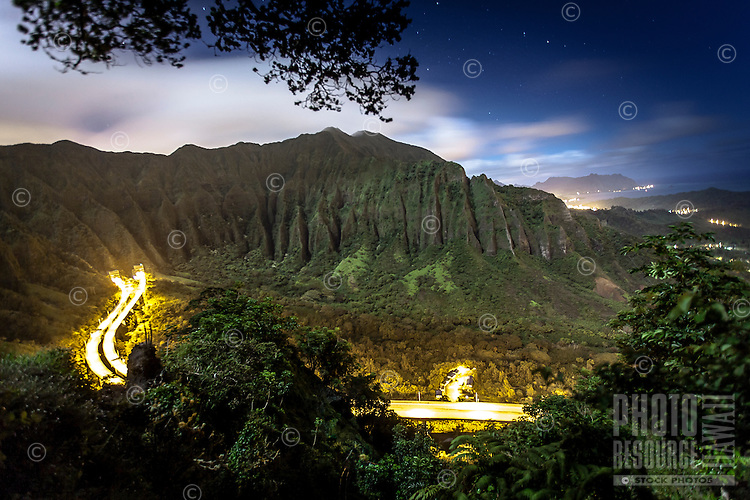 """An aerial view of the Ko'olau Range and H-3 Highway in Haiku Valley at night from Ha'iku Stairs (or """"Stairway to Heaven"""") hiking trail in Kane'ohe, O'ahu."""