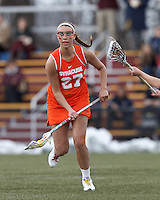 Syracuse University midfielder Kelly Cross (27) looks to pass.  Syracuse University (orange) defeated Boston College (white), 17-12, on the Newton Campus Lacrosse Field at Boston College, on March 27, 2013.