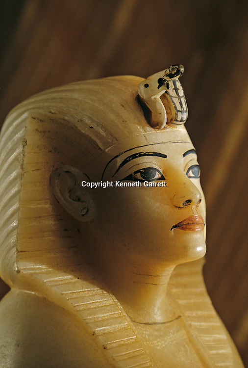 Alabaster canopic vase stopper,Tutankhamun and the Golden Age of the Pharaohs, Page 220