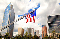 The Charlotte Fire Department hoisted a giant American flag from the top of a ladder truck to welcome participants to the annual Metropolitan Fire Chiefs Conference May 14-18, 2011.  The association, organized in 1965, anually brings together the fire chiefs of large metropolitan fire departments to share ideas, information and experiences.