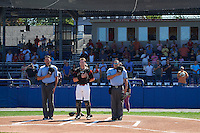 Umpires Emil Jimenez (left) and Robert Nunez (right) stand with Batavia Muckdogs catcher Alex Jones (55) for the national anthem before a game against the Auburn Doubledays on September 5, 2016 at Dwyer Stadium in Batavia, New York.  Batavia defeated Auburn 4-3. (Mike Janes/Four Seam Images)